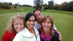 Here's Doris having fun with staff at Indellient's golf tournament.