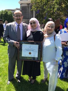 Here's Anwar and her parents celebrating her Commencement this past June.