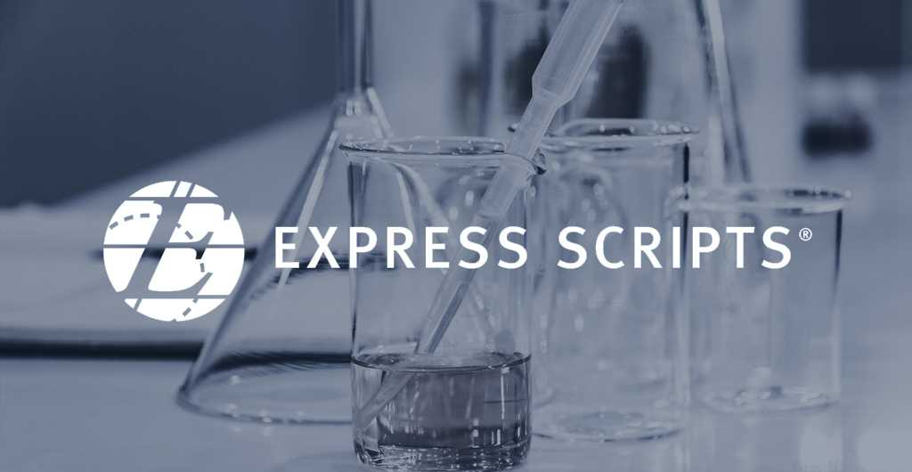Stock image of various sized beakers on a laboratory counter, with the front-most beaker being a quarter filled with a liquid and a long pipette taking in liquid, and the Express Scripts logo overtop the image