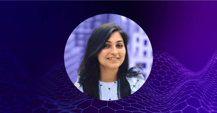 Jayeeta Putatunda Data Scientist at Indellient on top of purple and blue gradient
